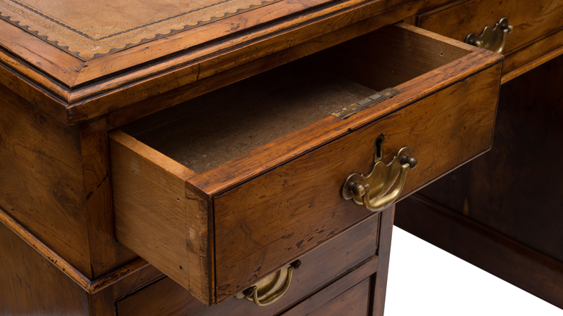 An Ajar Drawer of an Antique Wooden Office Table